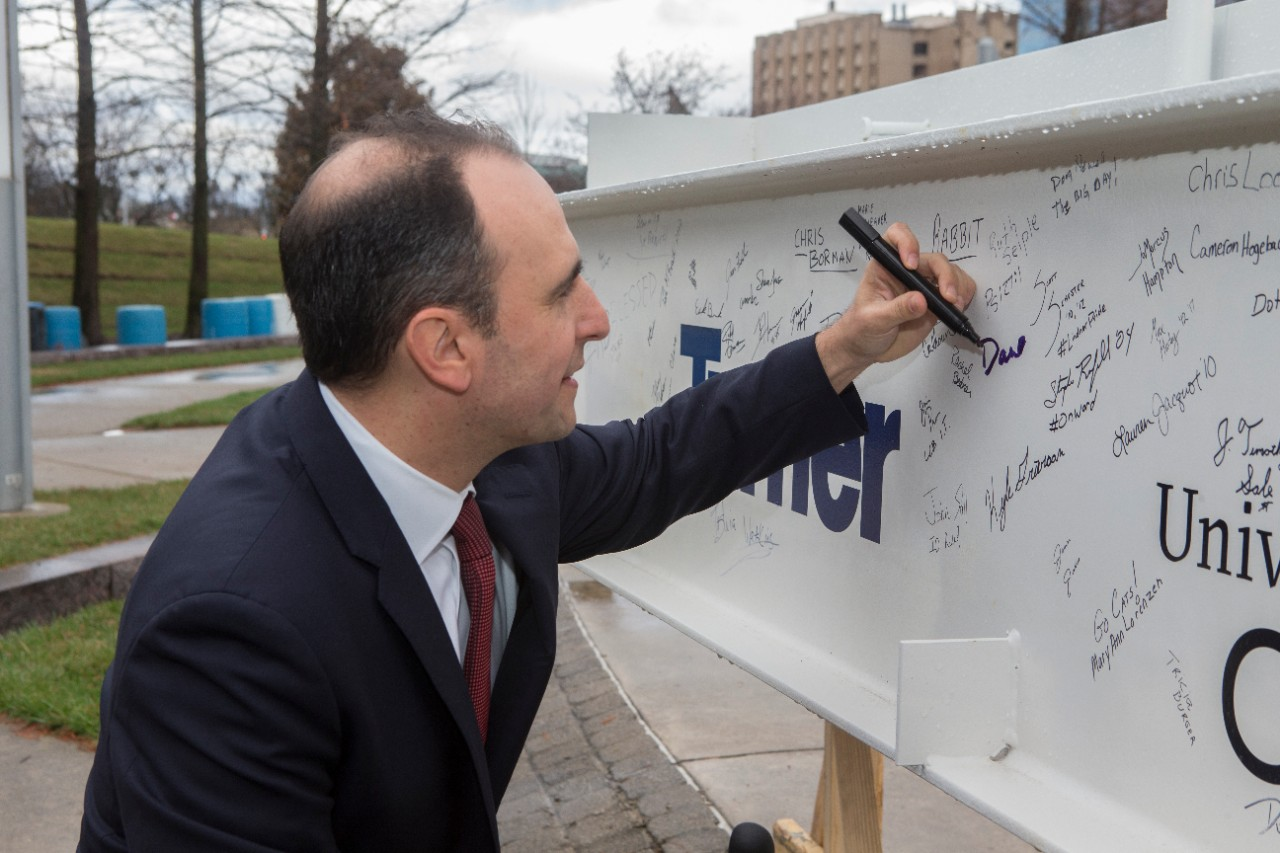 Lindner Associate Dean Dan Gruber signs the beam.