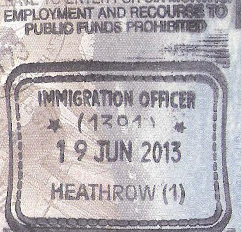 A passport stamp reads Heathrow.