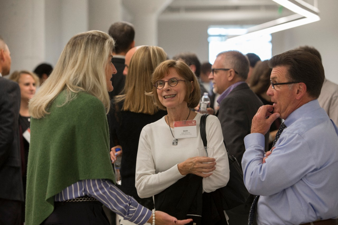 UC Architect Mary Beth McGrew speaks with other guests at the ribbon cutting.