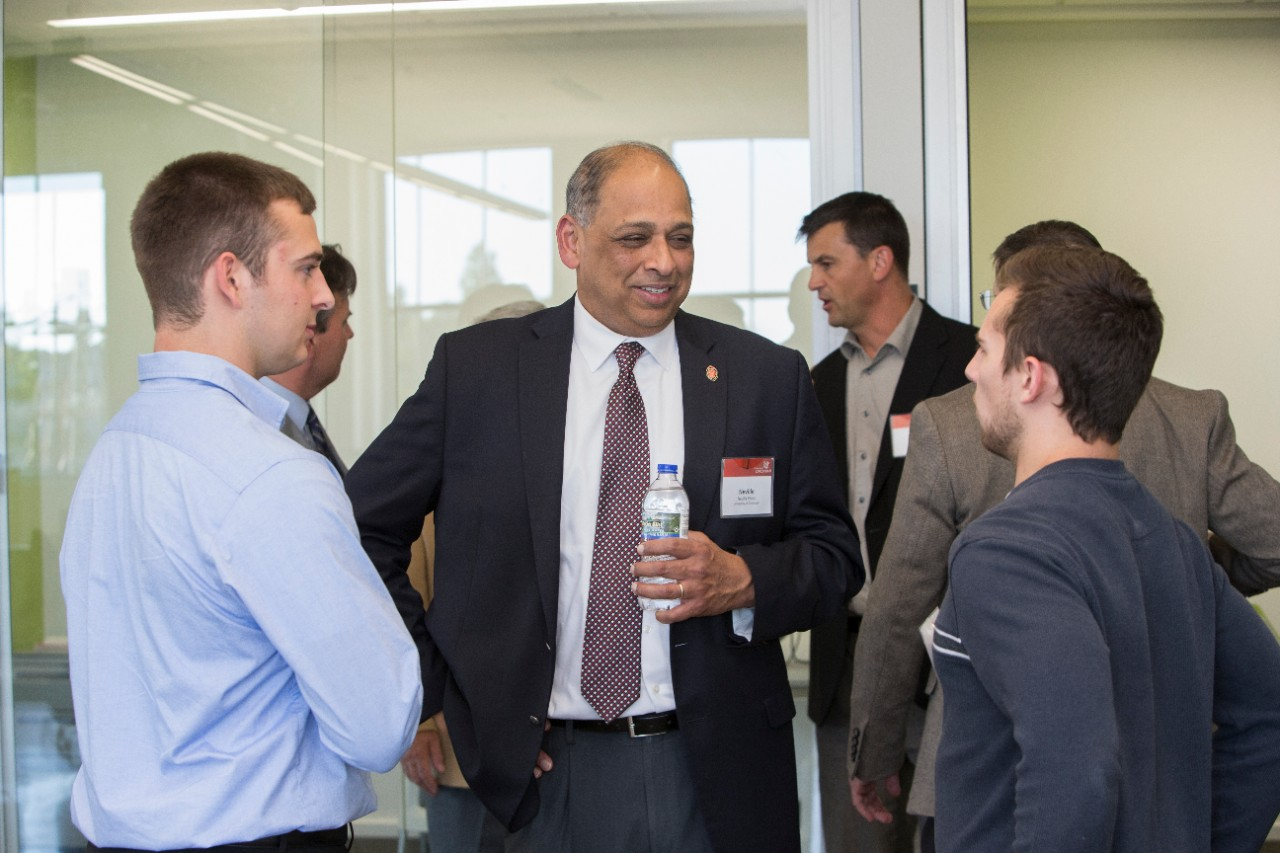 UC President Neville Pinto speaks with guests in the UC Simulation Center after the ribbon cutting ceremony.