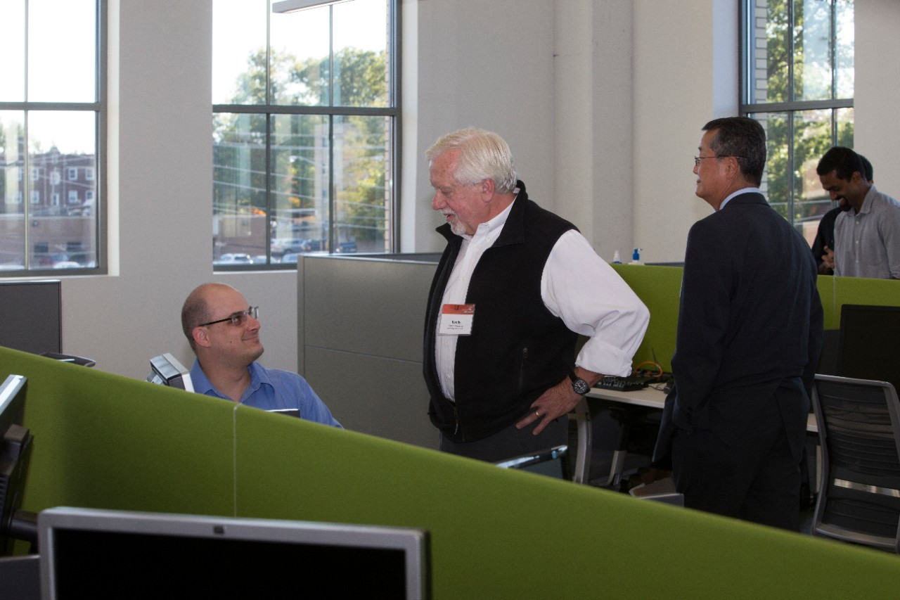 Guests chat inside the UC Simulation Center.