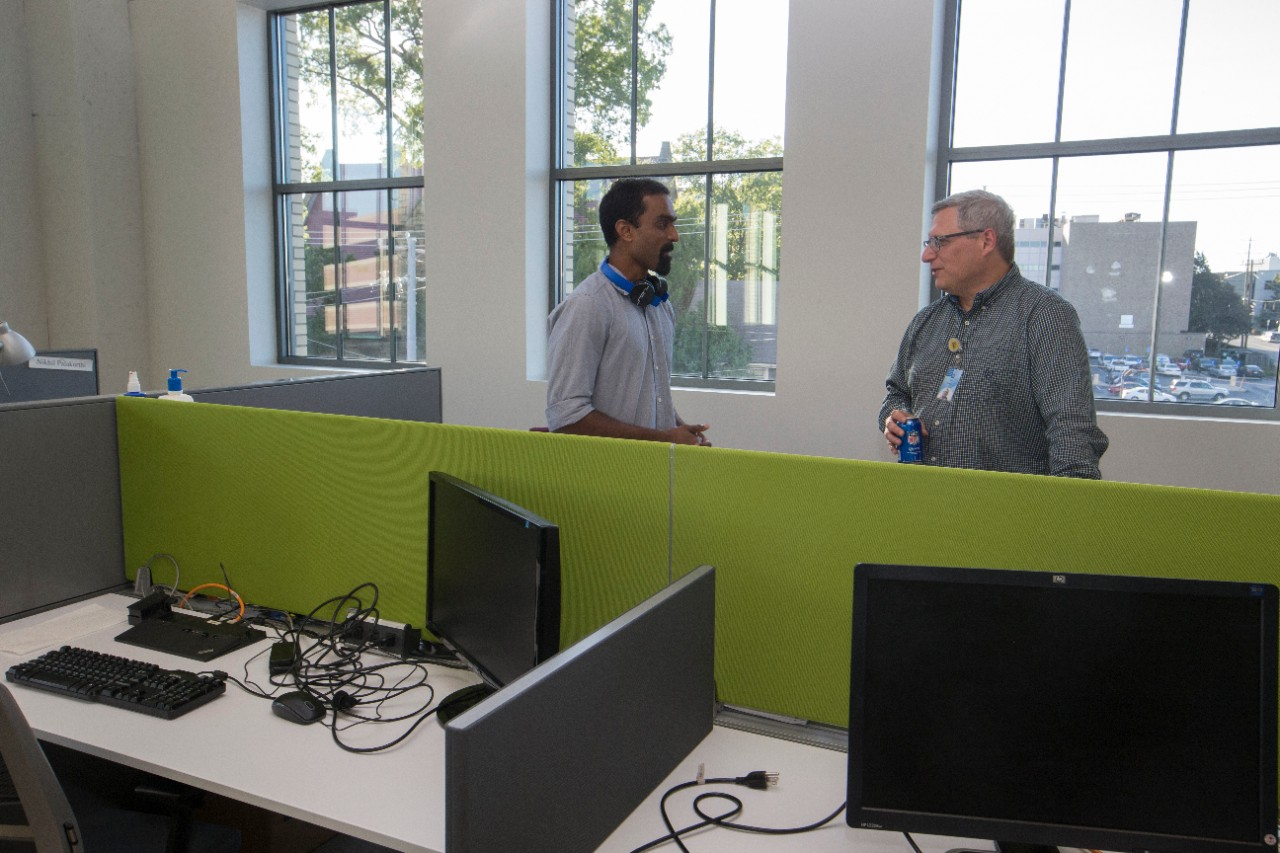 Two guests tour the UC Simulation Center.
