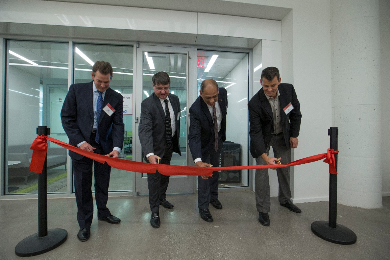 UC and P&G officials cut a red ribbon to celebrate the opening of the UC Simulation Center at the 1819 Innovation Hub.