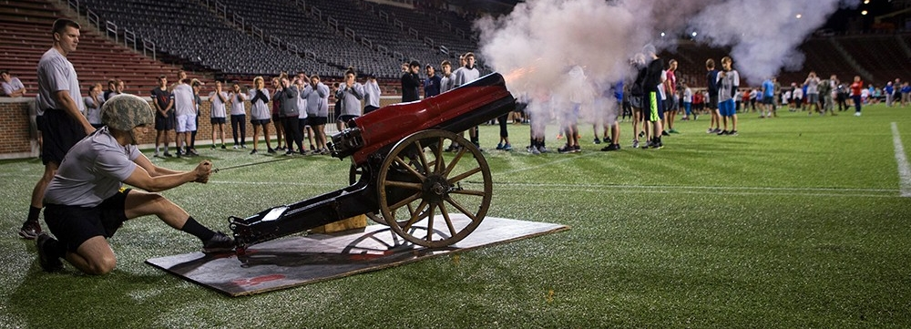 A U.S. Army ROTC soldier fires a cannon, signalling the start of the third annual 9/11 Stadium Stair Run.