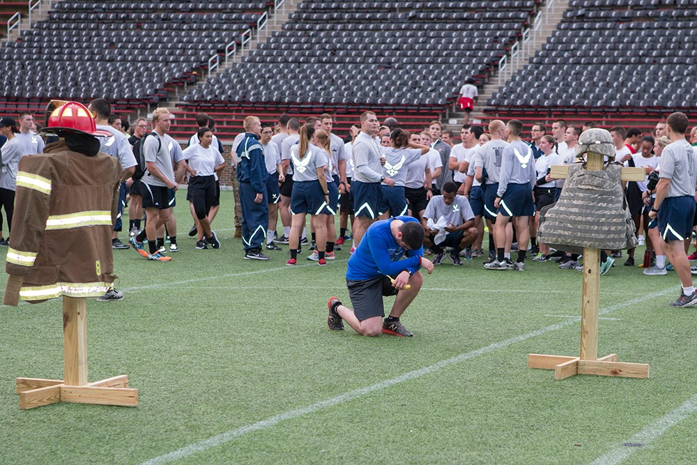 A man kneels and prays after the conclusion of the 9/11 Stadium Stair Run.