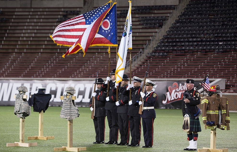 A color guard presents the flags of the United States and Ohio at the third annual 9/11 Stadium Stair Run.