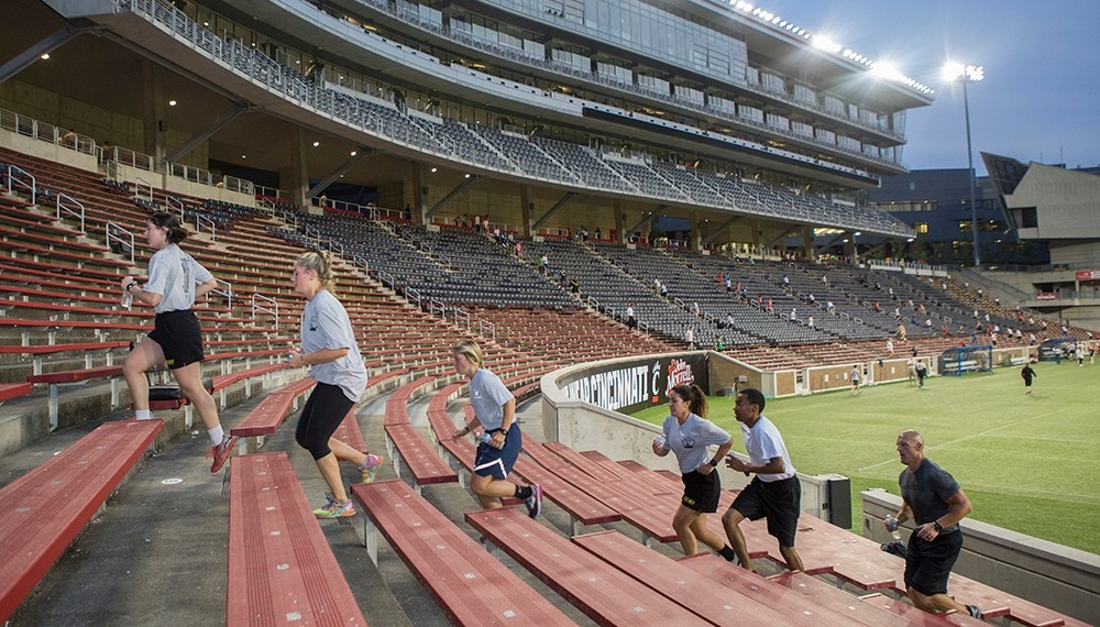 Participants run up the stairs.