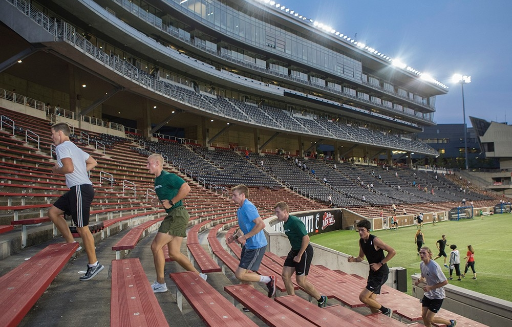 Six runners make their way up the steps at Nippert Stadium at the third annual 9/11 Stadium Stair Run on Monday, Sept. 11.
