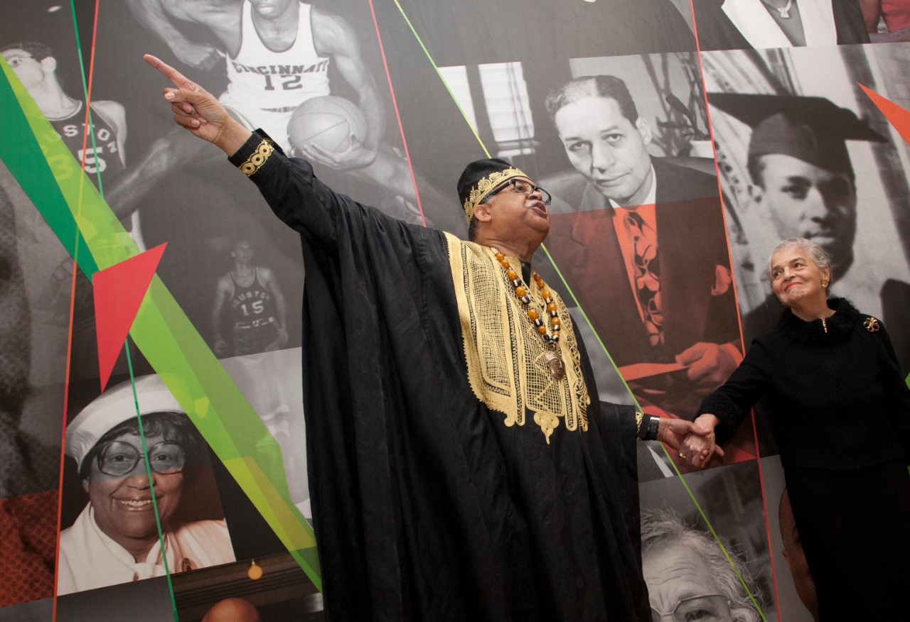 Eric Abercrumbie, left, points toward the ceiling with his right hand while holding Marian Spencer's hand with his left.