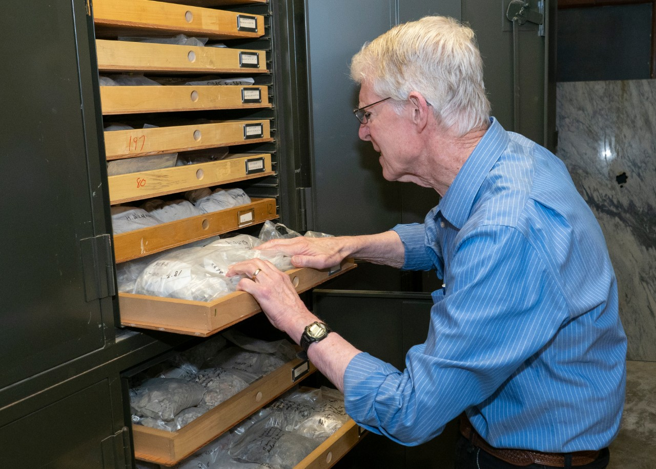 UC professor Warren Huff has filled rows of wall-to-ceiling storage cabinets with rock and clay samples he has collected all over the world for his research.