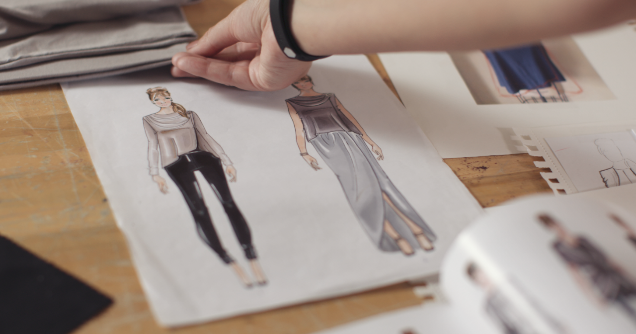 Sketches of dresses on a table