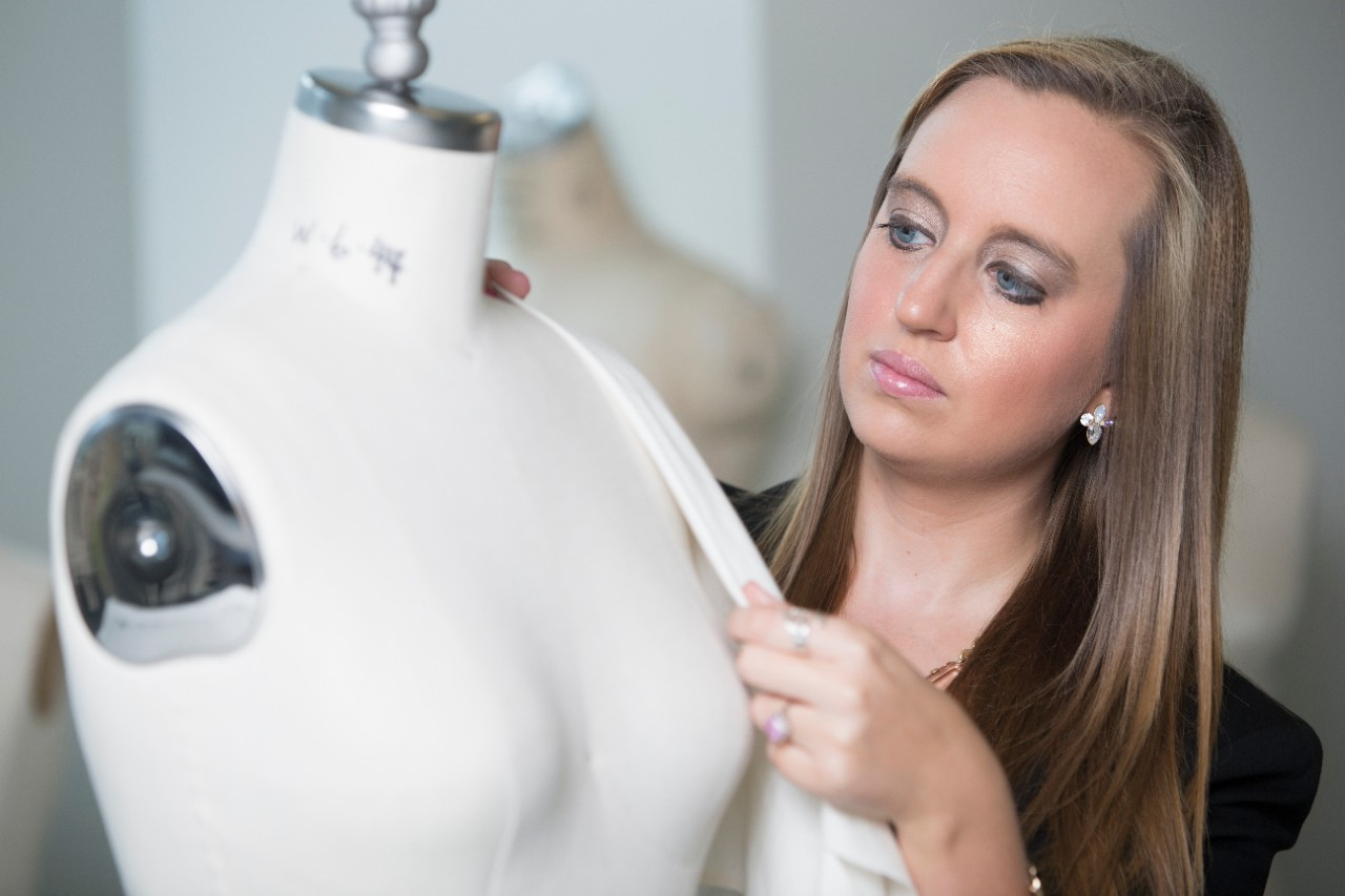 UC alum Megan Sullivan experiments with fabric on a mannequin.