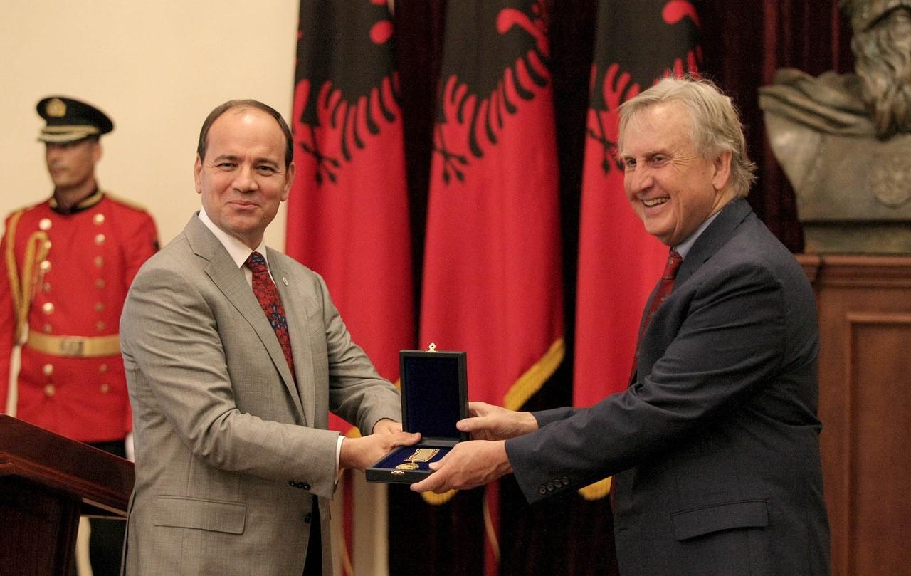 UC archaeologist Jack Davis accepts an award from Albanian president Bujar Nishani
