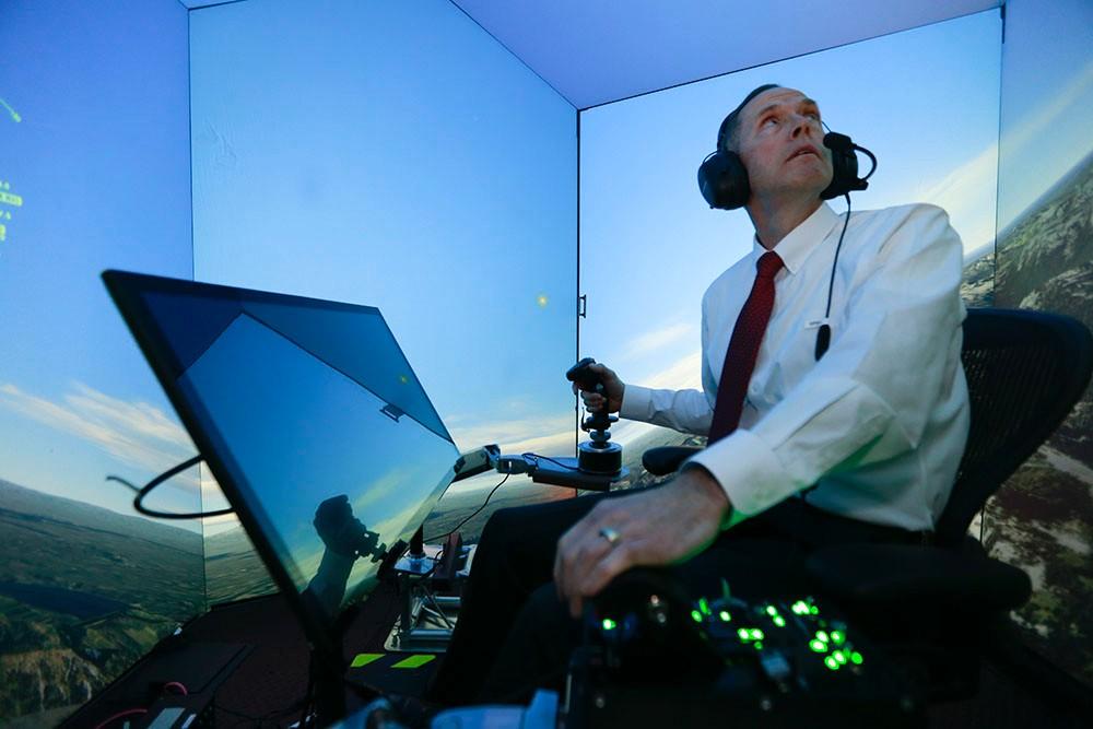 Gene Lee in a flight simulator.