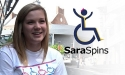 Sara 'Spins' in a wheelchair