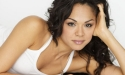 Karen Olivo lies on the floor leaning on her hand