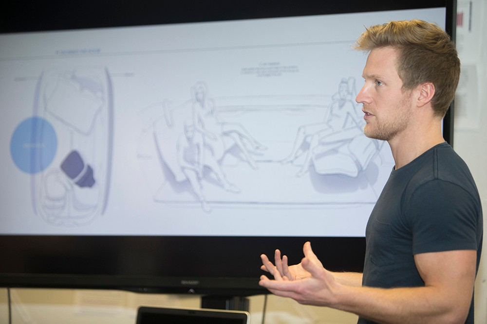 DAAP transportation design student Raleigh Haire presents his concepts for the interior of an autonomous car.