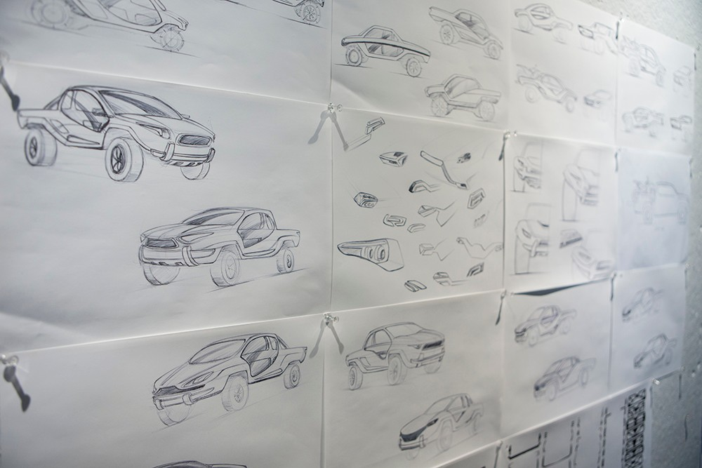 Vehicle design sketches cover the walls in DAAP's transportation design studio.