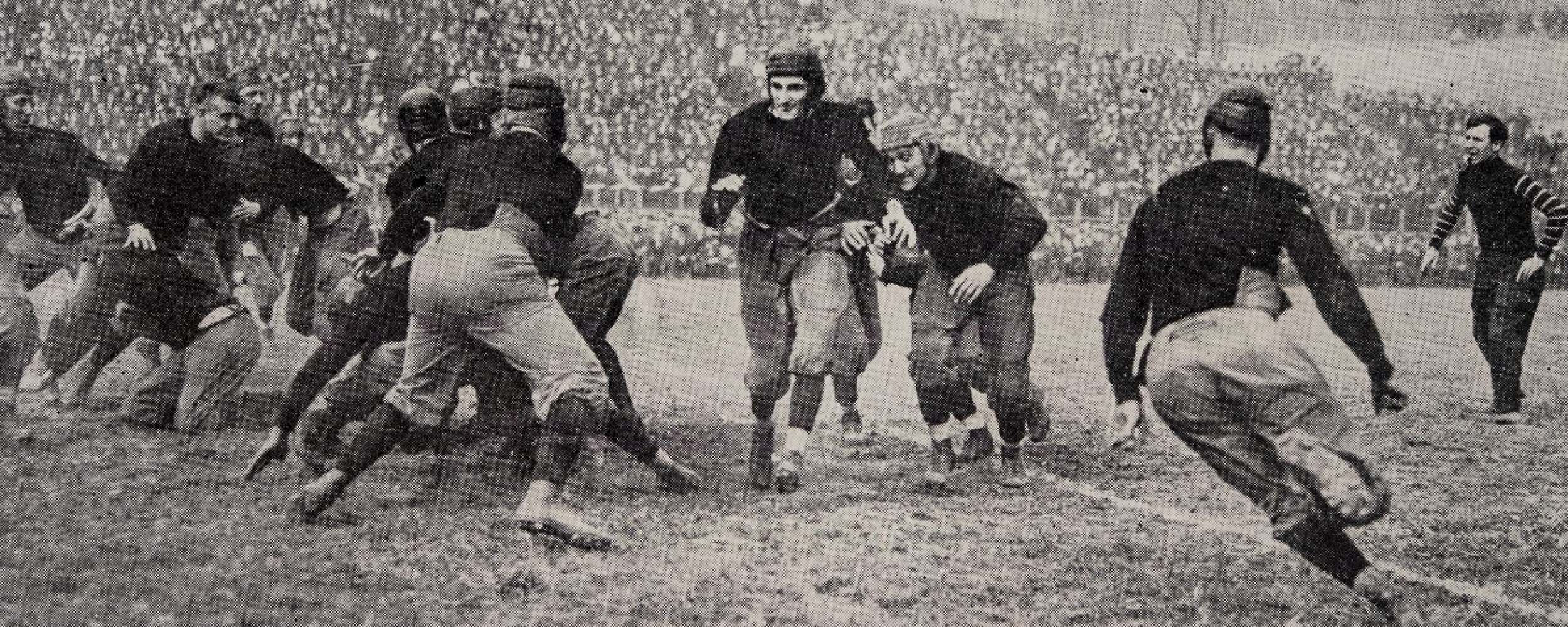 Leonard Teddy Baehr carries the ball at UC on Oct. 31, 1914.
