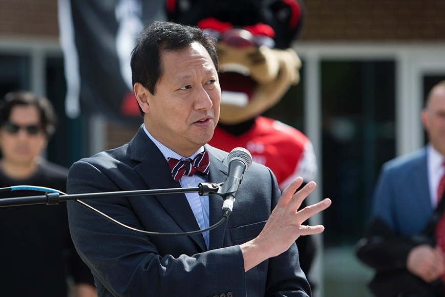 The University of Cincinnati President Santa Ono addresses the people gathered for the unveiling of a UC Bearcat statue.