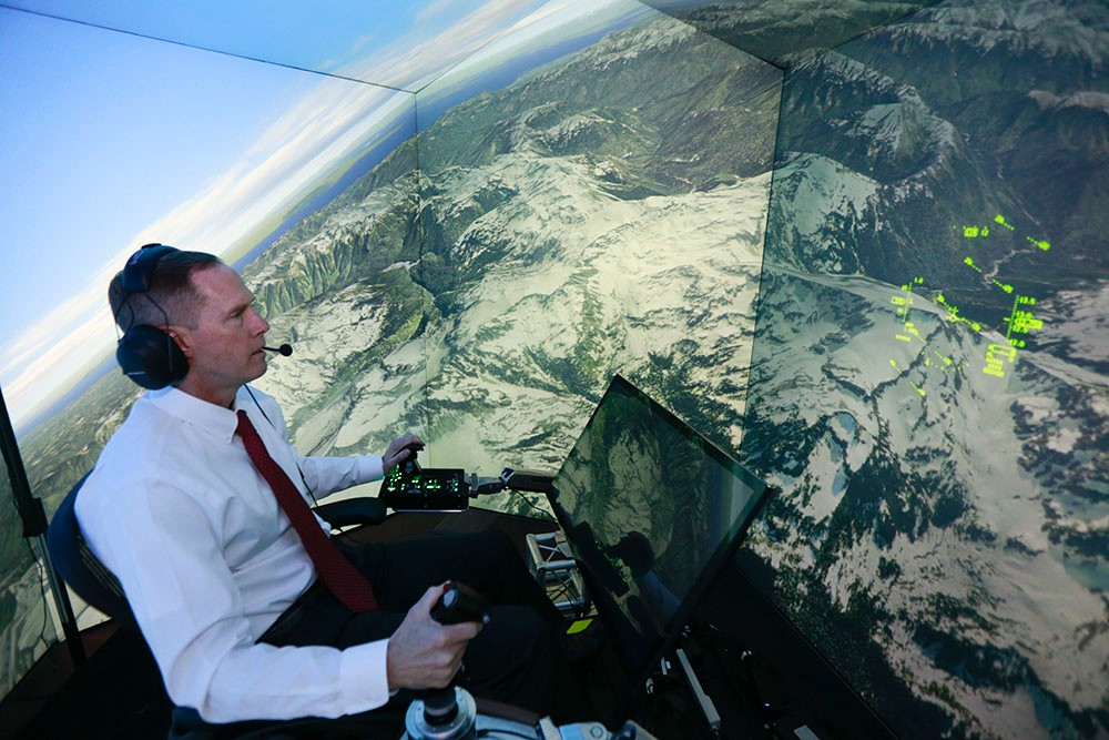 Ret. U.S. Air Force Col. Gene Lee pilots a fighter plane in a virtual combat simulation against enemies controlled by an artificial intelligence called Alpha at the Wright-Patterson Air Force Base. The developer of that system, Psibernetix, Inc., is working with UC researchers to diagnose and treat bipolar disorder. (Lisa Ventre/UC Creative Services)