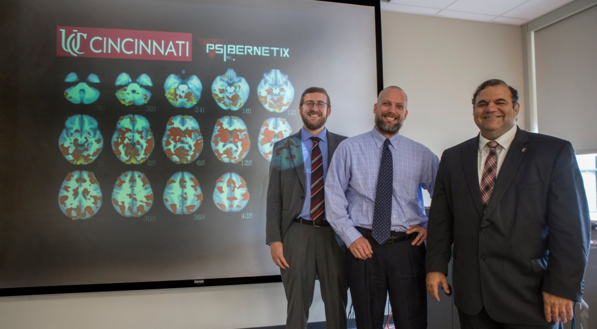 UC graduate and Psibernetix CEO Nicholas Ernest, left, and UC researchers David Fleck and Kelly Cohen used artificial intelligence to predict treatment outcomes for bipolar patients.