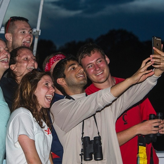 Students pose for a selfie while on the Amazon River.