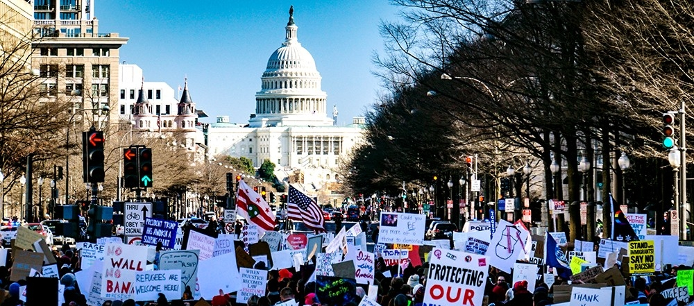 Activists rally in Washington, D.C. on Feb. 4, 2017, in protest of President Donald Trump's executive order halting all refugee admissions and temporarily barring people from seven Muslim-majority countries