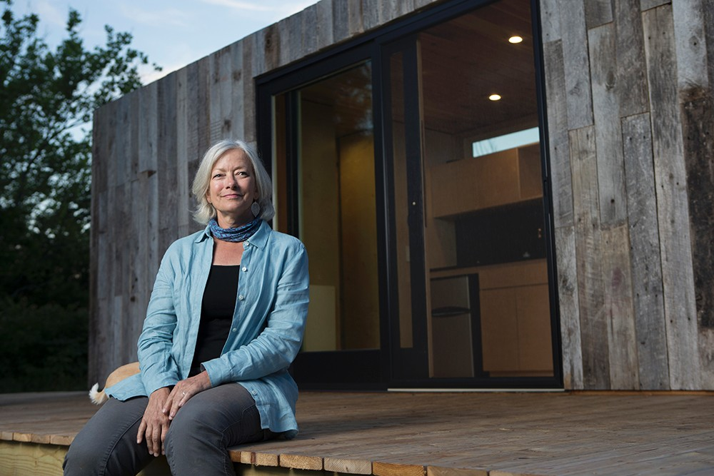 Land steward Adrienne Cassel sits on the deck of her tiny house on the Kamama Prairie.