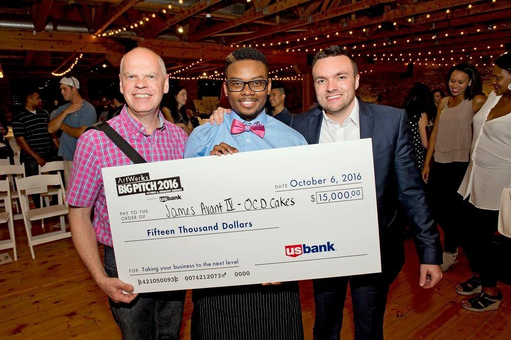 James Avant poses with mentors Paul Picton (left) and Michael Howard (right) with a giant check for $15,000 after winning the Big Pitch competition.