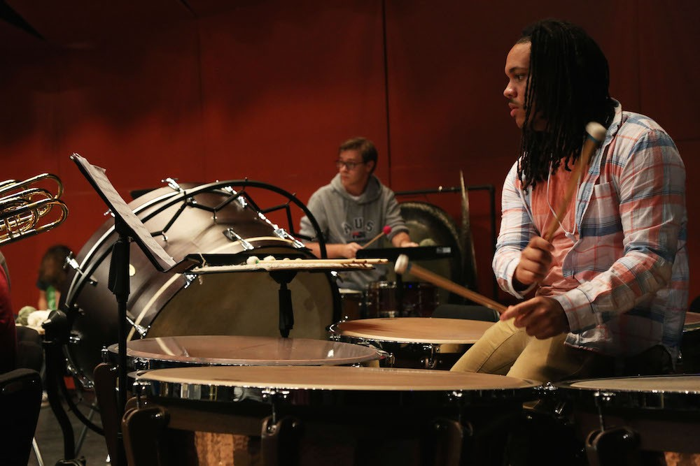 Student plays the timpani drums