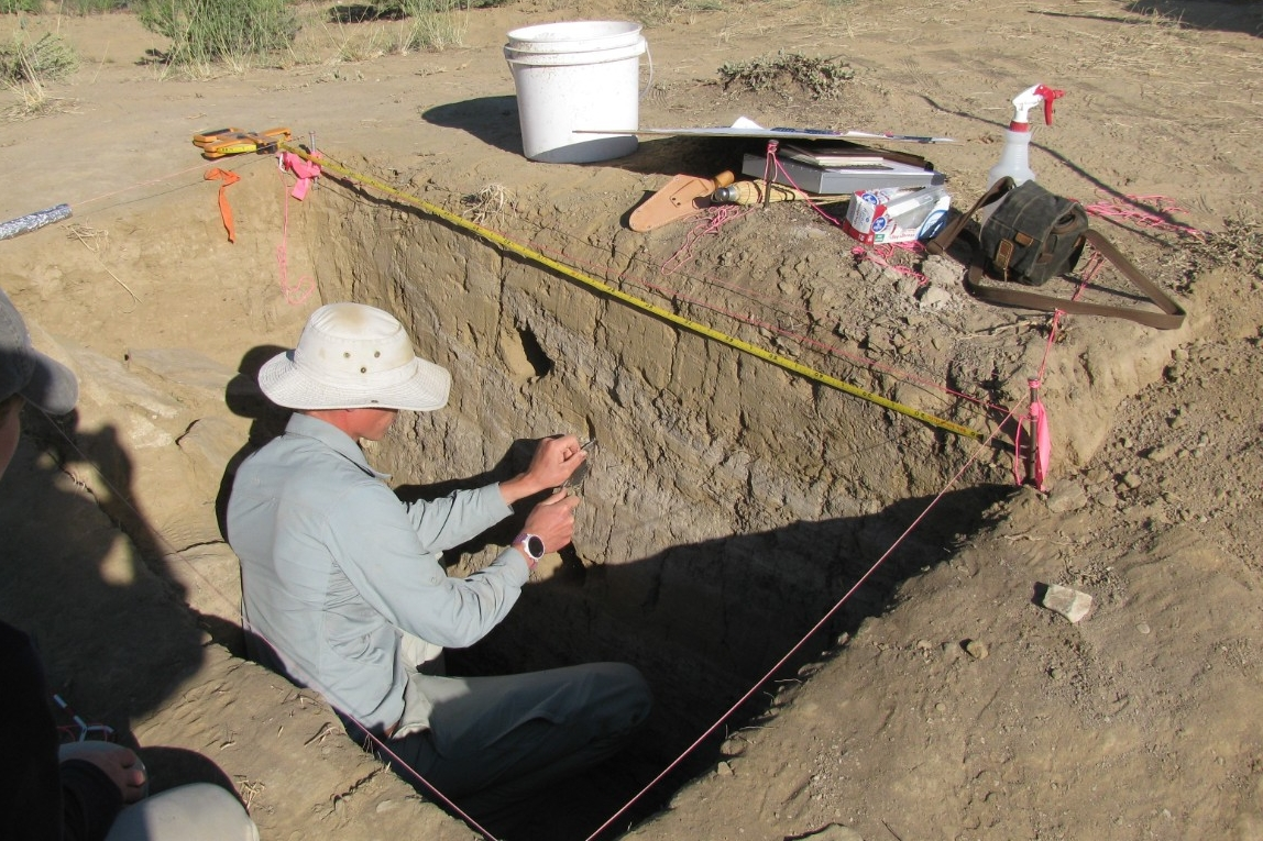 UC graduate Jon-Paul McCool takes soil samples at an excavation site in what is believed to be a former canal at Chaco Canyon. (Photo by Nicholas Dunning)