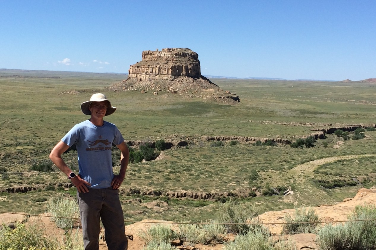 UC graduate Jon-Paul McCool stands atop a mesa overlooking New Mexico's desert. (Samantha Fladd)