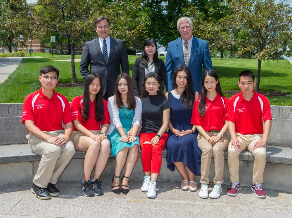 "UC will welcome about 60 engineering students this year from Chongqing University. Pictured are UC College of Engineering and Applied Science Interim Dean Paul Orkwis, left, program coordinator Xiaoqun ""Sherry"" Liao and Associate Dean of Undergraduate Affairs Arthur Allen. Seated from left are students Jinglun Yu, Yuelin Fan, Yixuan Zhang, Zijia Shen, Jingyi Zhu, Lingchi Li and Zhihao Sun."