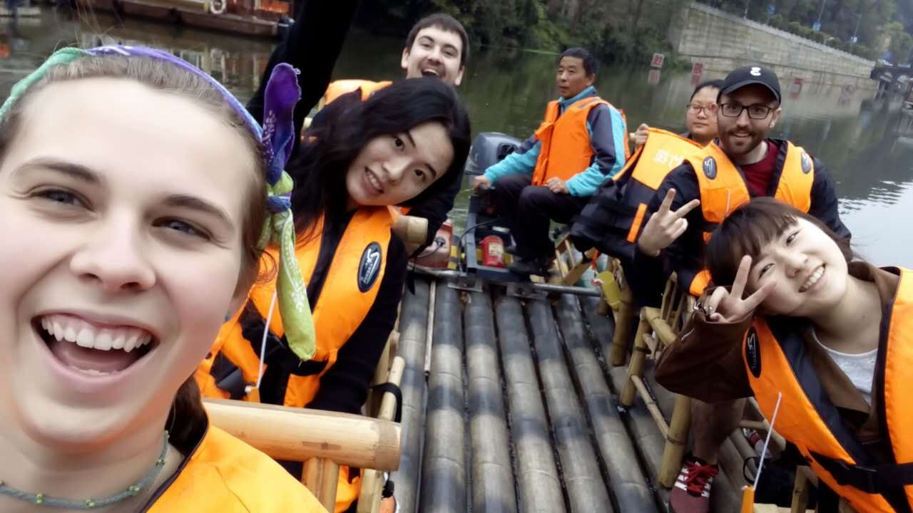 UC teaching assistants Jessica Francis, Nicholas Waits and Domenico Aracri take a boat ride with their students from Chongqing University.