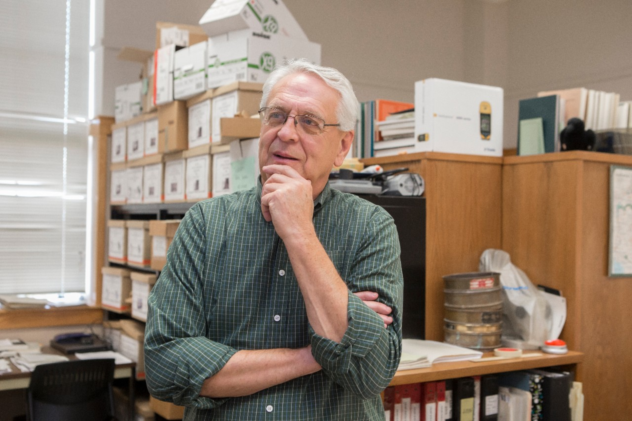 UC professor Alan Sullivan, pictured in his office in the Department of Anthropology, has spent more than 30 years studying the prehistoric peoples of the Southwest.