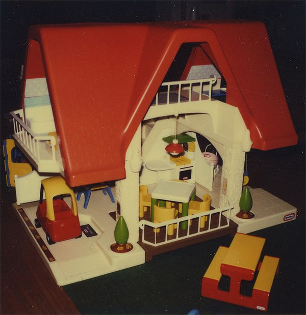 The Little Tikes Place, a dollhouse created in the late 1980s, consisted of some miniature versions of Mariol's creations such as the cozy coupe. In his original design, the roof was blue. Photo Courtesy of Jim Mariol