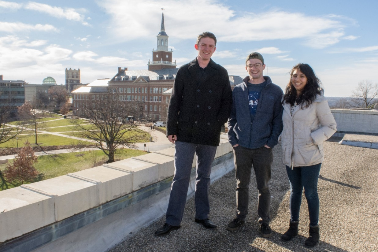 UC CubeCats members Alex McGlasson, left, Adam Herrmann and Himadri Pandey pose atop the Old Chemistry Building.