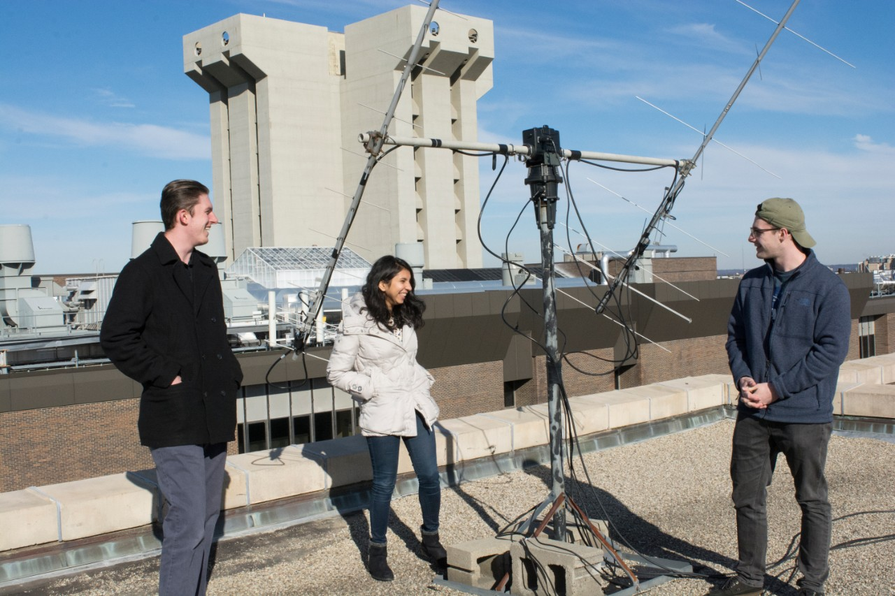 UC CubeCats members Alex McGlasson, left, Himadri Pandey and Adam Herrmann talk about sharing the UC Amateur Radio Club's antenna atop the Old Chemistry Building to download data from orbiting cubesats.