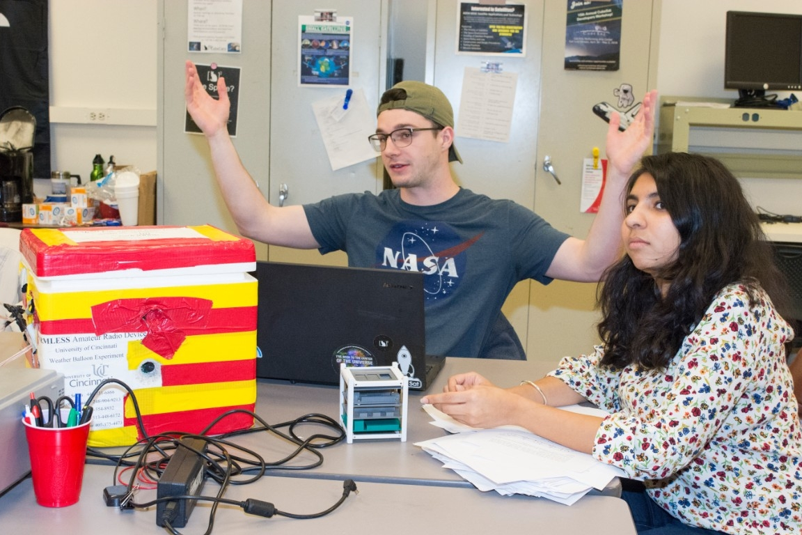 UC CubeCats founder Adam Herrmann, left, and President Himadri Pandey talk about the many space projects they considered before choosing to study radiation in space.