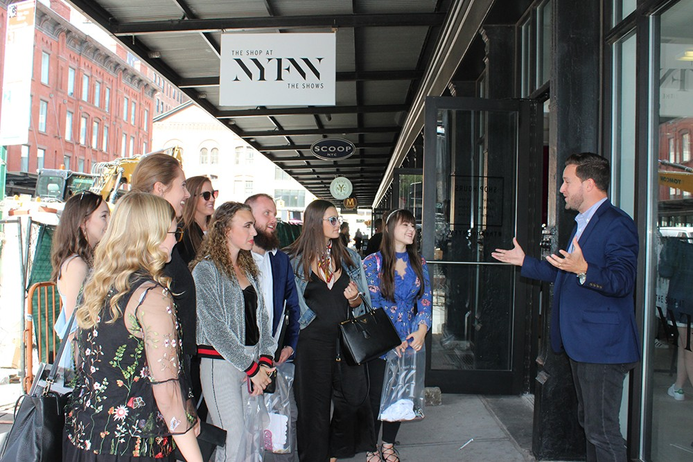 A group of students gather outside The Shops at NYFW, one element of the huge fashion event.