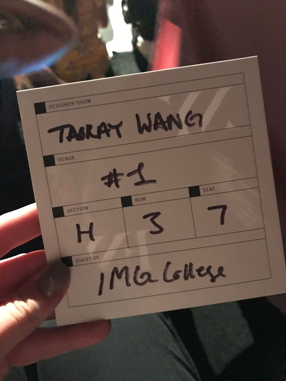 A white square pass to the Taoray Wan runway show at NYFW.
