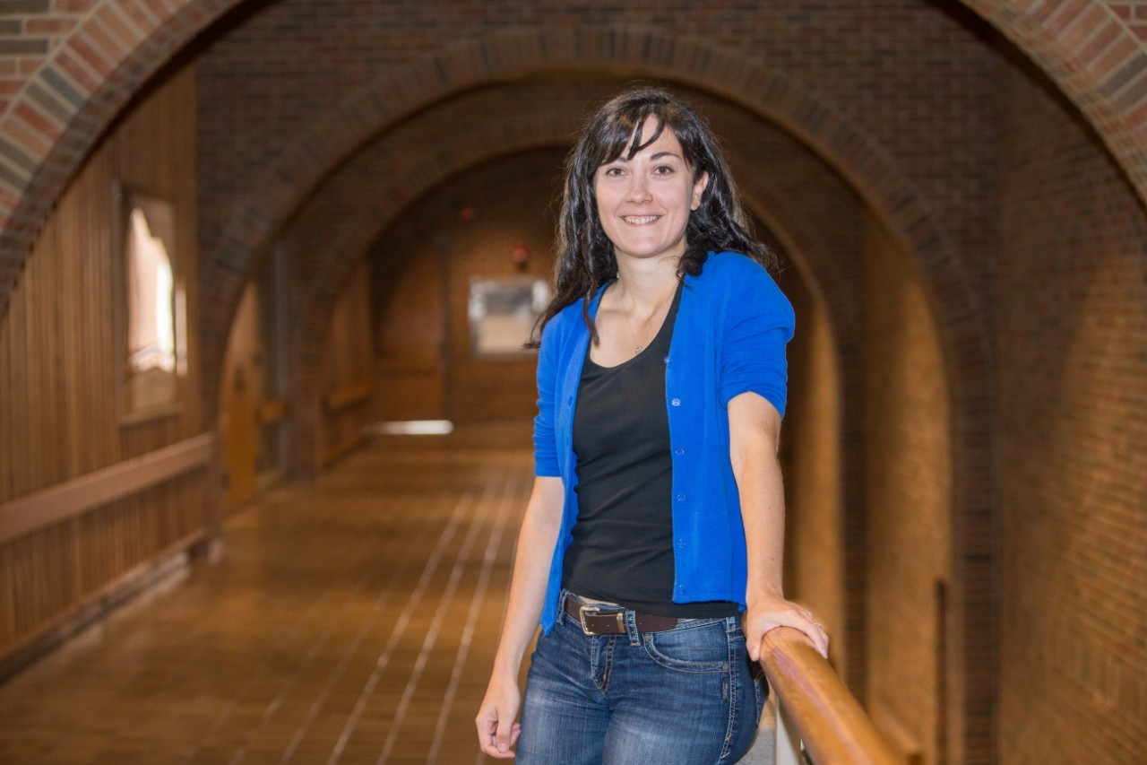 UC assistant professor of physics Stefania Gori outside her office in UC's Geology-Physics Building.