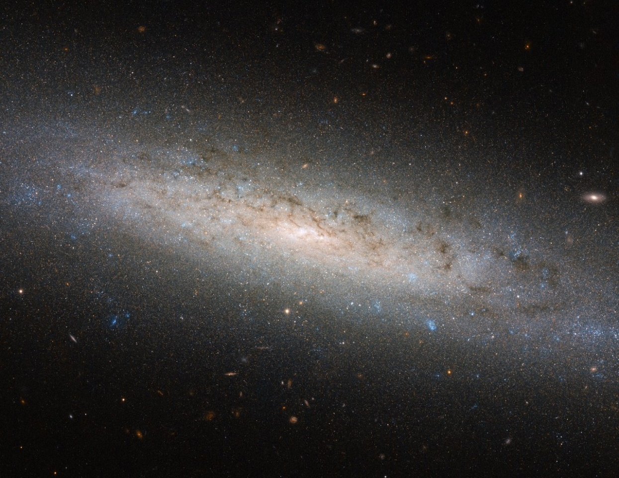 The Hubble Space Telescope captured this image of the galaxy NGC-24. Astrophysicists suspect these galaxies are surrounded by extended halos of dark matter. (NASA)