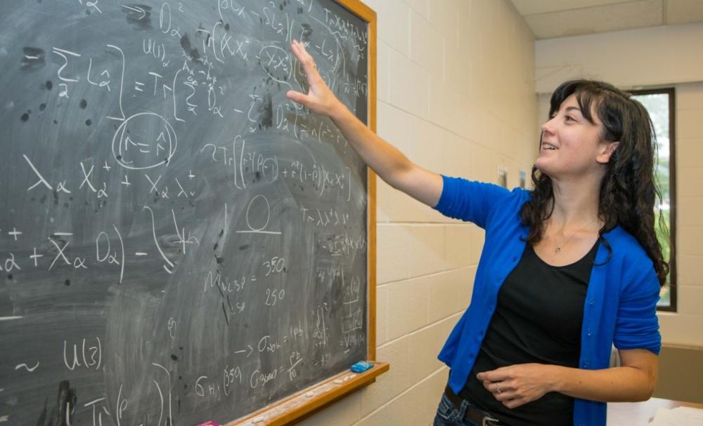 UC physics professor Stefania Gori discusses her dark matter research in her office.