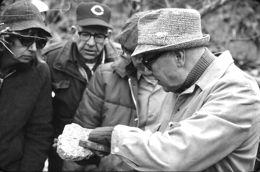 The late UC geology professor Kenneth Caster confers with other members of the Cincinnati Dry Dredgers over a find during a 1977 outing.