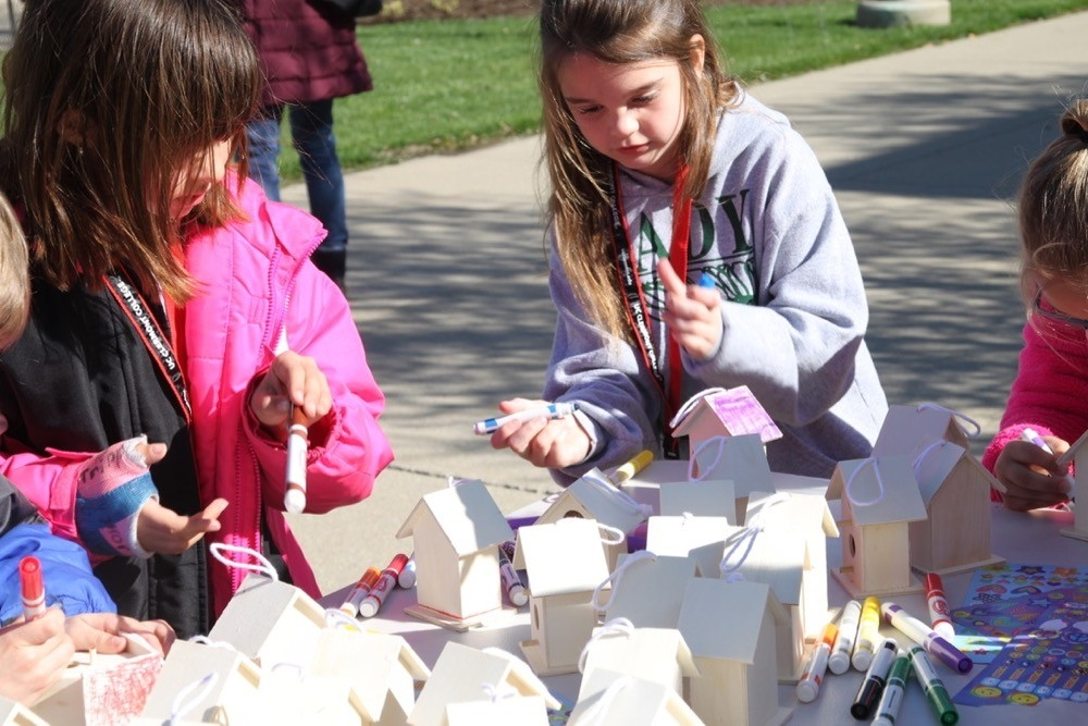 Second grade students from Batavia Elementary paint bird houses at UC Clermont's annual Earth Day festivities.