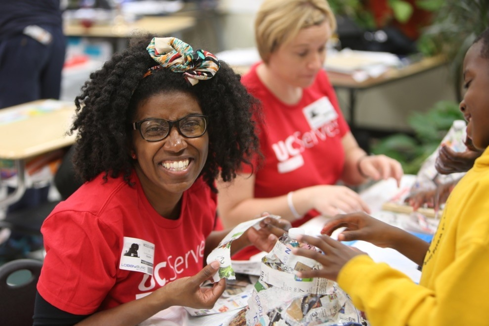 UC Serves volunteers engage with student
