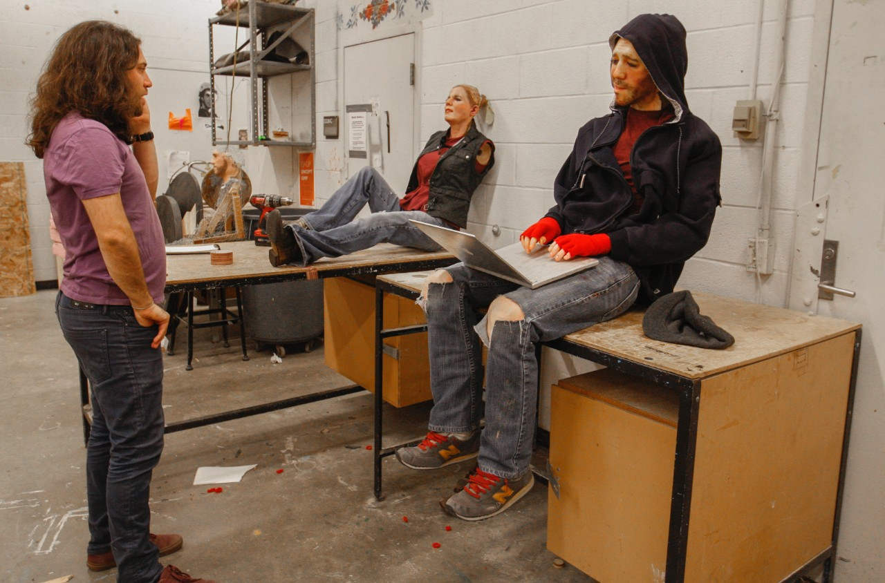 Alan Marrero pauses to look at the sculptures of Ethan and Violet in a DAAP studio.  Joe Fuqua/UC Creative Services