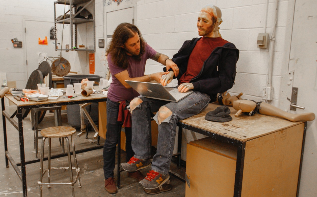 Alan Marrero works on a sculpture in a studio